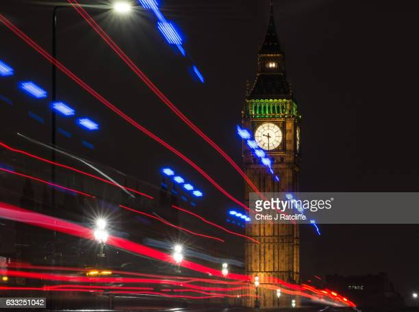 Light trails from an ambulance and cars over Westminster Bridge in front of Elizabeth Tower commonly known as Big Ben as the Ayrton light is on above...