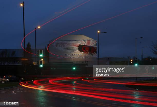 Light trails from commuters automobiles as they pass the Jaguar Land Rover automobile factory in Birmingham, U.K., on Thursday, Jan. 28, 2021. U.K....