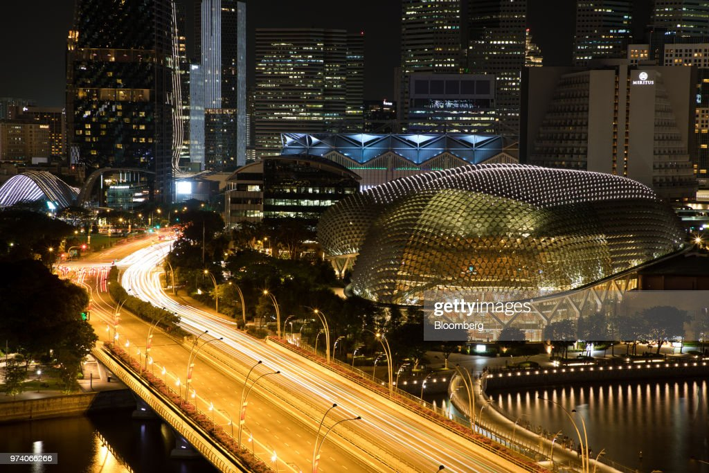 Light trails from moving traffic are seen on the bridge near to Esplanade Theatres on the Bay, in Singapore, on Wednesday, June 13, 2018. Tourism as well as the consumer sector will likely see a lift thanks to the influx of international media at the recent DPRK-USA Summit, according to RHB Research Institute Singapore Pte. Photographer: Brent Lewin/Bloomberg via Getty Images