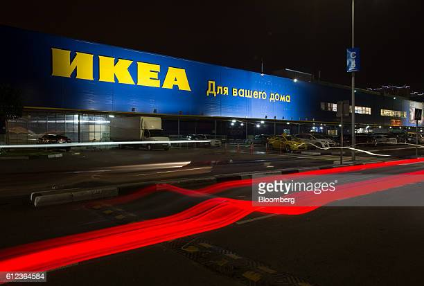 Light trails from passing automobiles illuminate an access road near the Ikea AB retail store in Khimki Russia on Monday Oct 3 2016 Ikea's Russia...