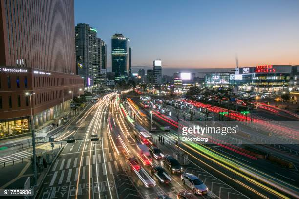Light trails from passing traffic illuminate a road at dusk in Seoul South Korea on Saturday Jan 27 2018 5G the fifthgeneration wireless network is...