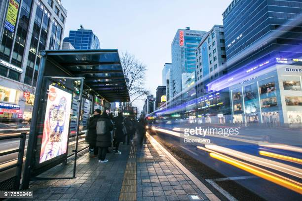Light trails from passing traffic illuminate a road next to a bus station at night in the Gangnam district of Seoul South Korea on Sunday Jan 28 2018...