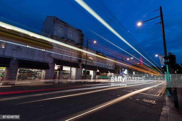 Light trails from passing vehicles are seen at dusk in the Little India area of Singapore on Wednesday June 13 2018 Tourism as well as the consumer...