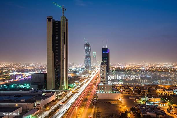 Light trails from traffic illuminate highways surrounded by residential buildings in Riyadh Saudi Arabia on Friday Jan 8 2016 Saudi Arabian stocks...