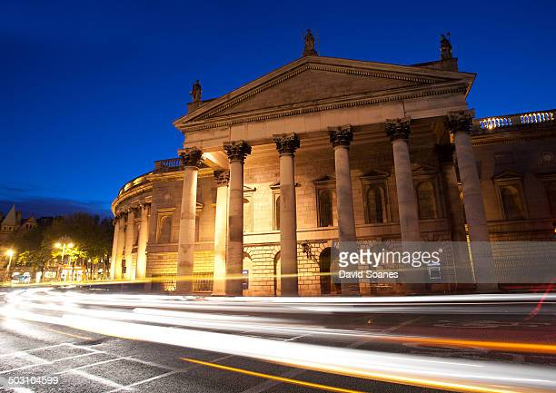Light trails going by the Bank of Ireland building at College Green in Dublin City.