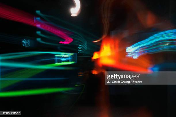 light trails in city at night - electronic music stock pictures, royalty-free photos & images