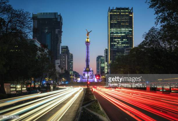 light trails in city at night - mexico city stock pictures, royalty-free photos & images