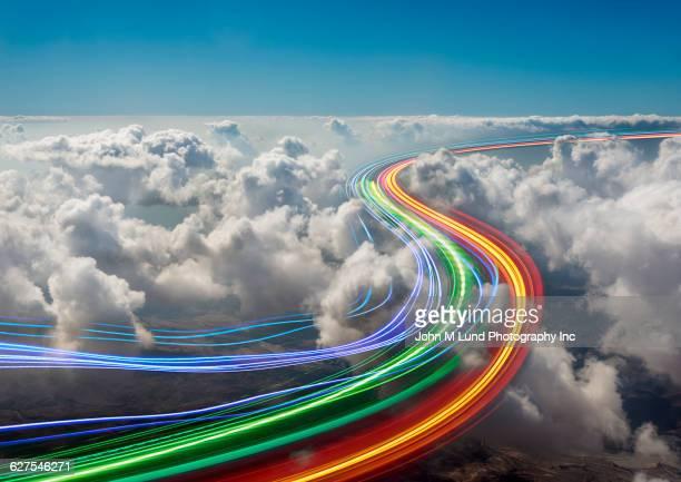 Light trails in clouds in sky