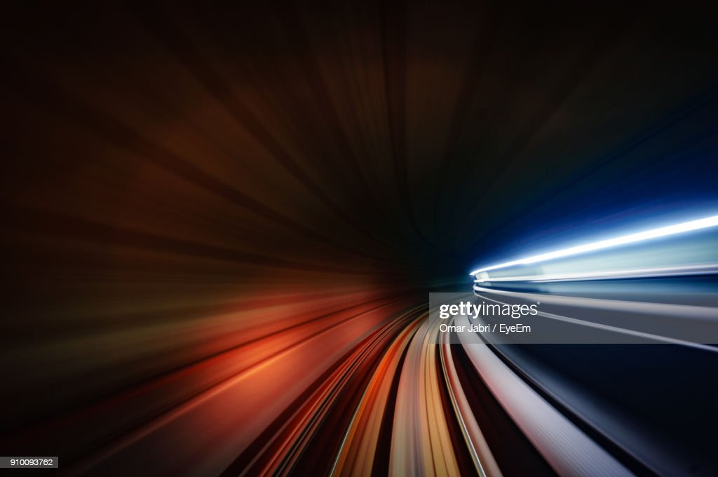 Light Trails In Illuminated Tunnel At Night : Stock Photo
