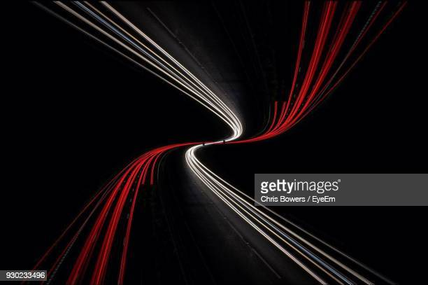 light trails in illuminated tunnel - light trail stock pictures, royalty-free photos & images