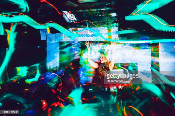 Light Trails in Nightclub, Female DJ Mixing Music
