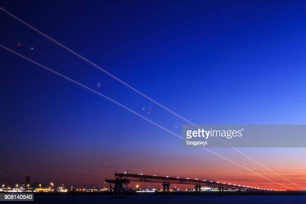 light trails in twilight sky - isogawyi stock pictures, royalty-free photos & images