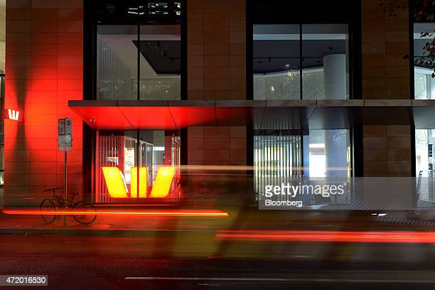 Light trails left by moving traffic past a Westpac Banking Corp office building in this long exposure photograph taken at night in Melbourne...
