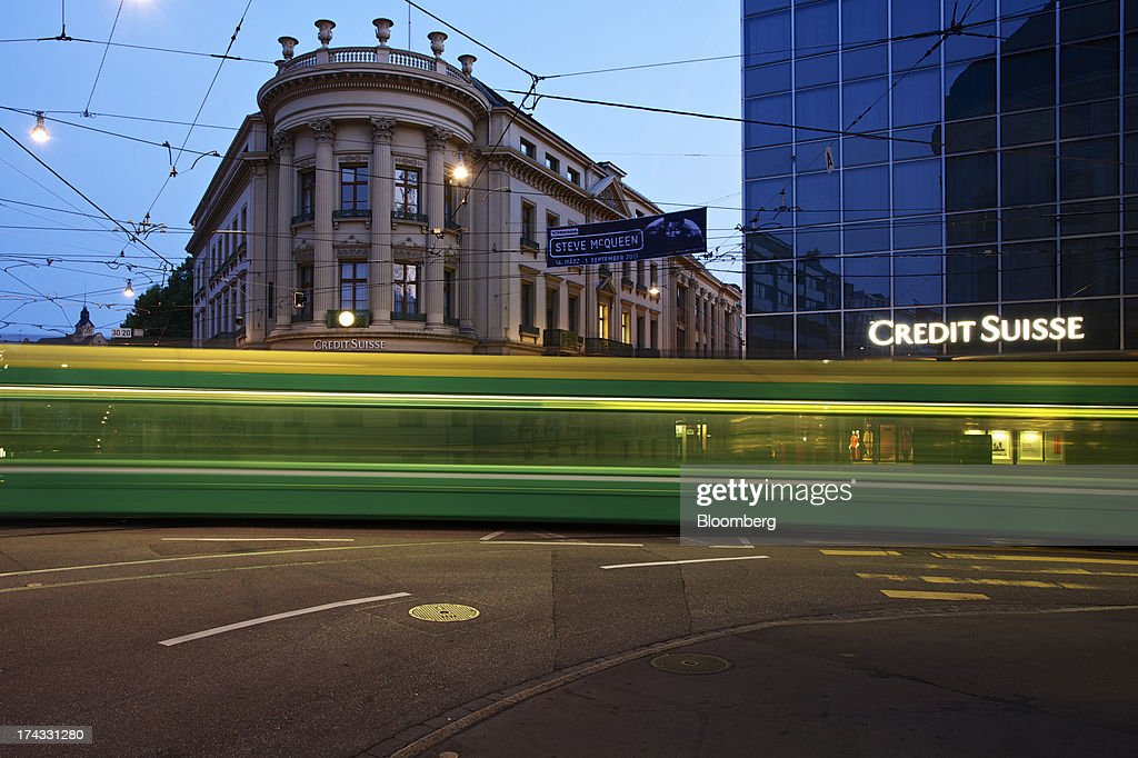 Light trails made by a passing tram are seen in front of the offices of Credit Suisse Group AG in Basel, Switzerland, on Tuesday, July 23, 2013. Europe's biggest banks, which more than doubled their highest-quality capital to $1 trillion since 2007 to meet tougher rules, may have further to go as regulators scrutinize how lenders judge the riskiness of their assets. Photographer: Gianluca Colla/Bloomberg via Getty Images