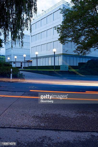 Light trails made by passing vehicles are seen in front of Glencore International Plc's headquarters in Baar, Switzerland, on Friday, Aug. 24, 2012....