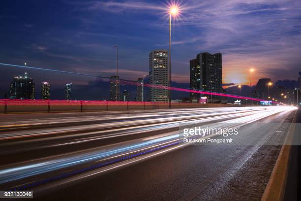 Light trails of cars on a bridge in city at night