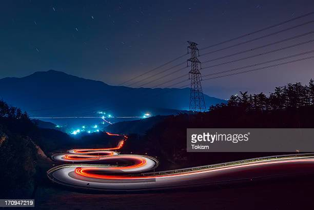 Light trails of cars on the zigzag way.