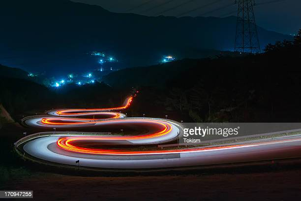 Light trails of cars on the zigzag way