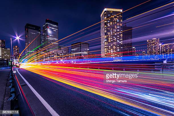 light trails of harumi street - light trail stock pictures, royalty-free photos & images