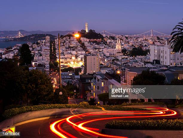 light trails of lombard street - lombard street san francisco stock pictures, royalty-free photos & images