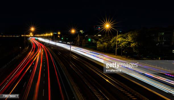 Light trails on a freeway at night, Perth, Western Australia, Australia