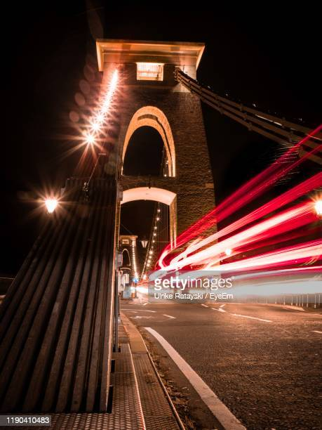 light trails on bridge in city at night - bristol stock pictures, royalty-free photos & images