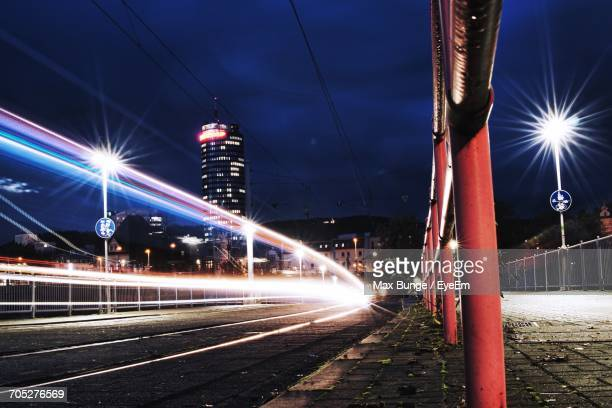 Light Trails On Bridge In City At Night