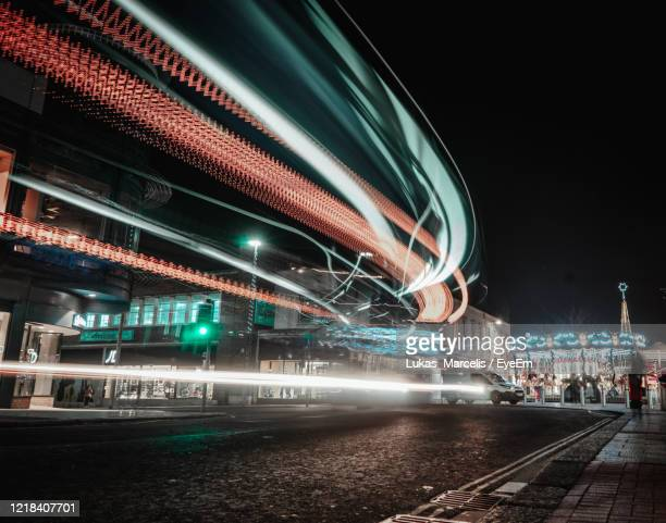 light trails on bridge over city against sky at night - southampton england stock pictures, royalty-free photos & images