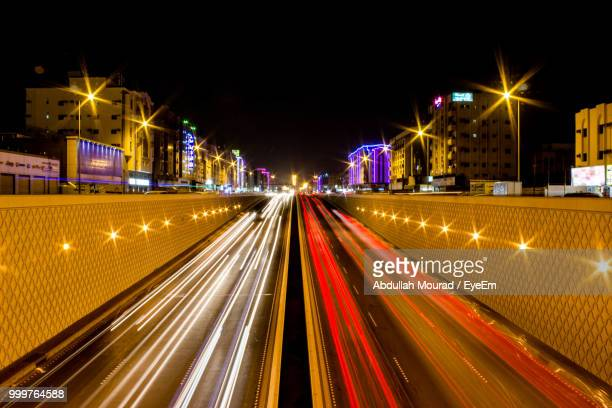 light trails on city street at night - jiddah stock pictures, royalty-free photos & images