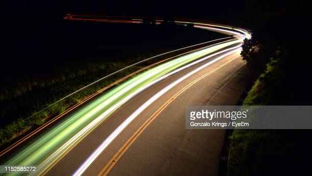 light trails on highway at night - krings stock pictures, royalty-free photos & images
