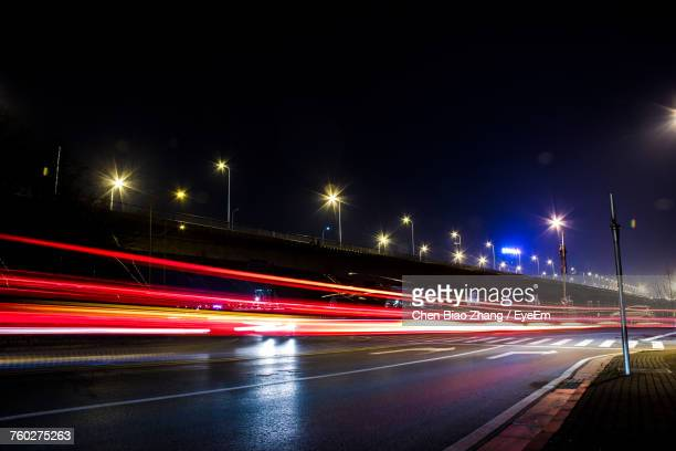 light trails on highway at night - long exposure stock pictures, royalty-free photos & images