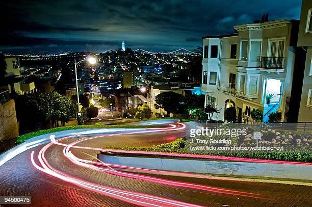 light trails on lombard street - lombard street san francisco stock pictures, royalty-free photos & images