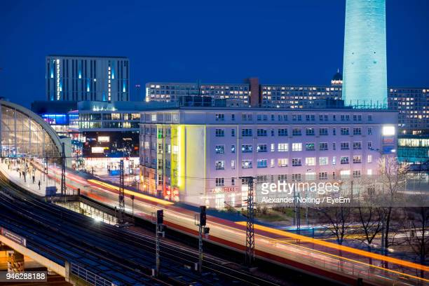 Light Trails On Railroad Station In City At Night