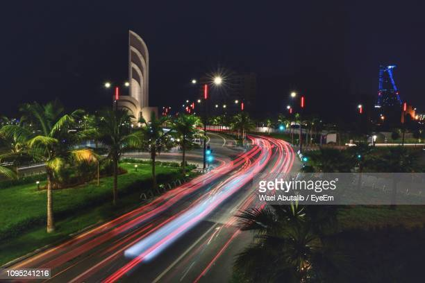 light trails on road against sky at night - jiddah stock pictures, royalty-free photos & images