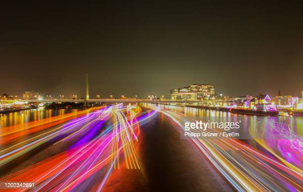 light trails on road against sky at night - north rhine westphalia stock pictures, royalty-free photos & images