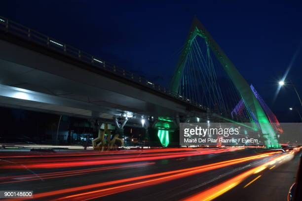 light trails on road against sky at night - guadalajara mexico stock pictures, royalty-free photos & images