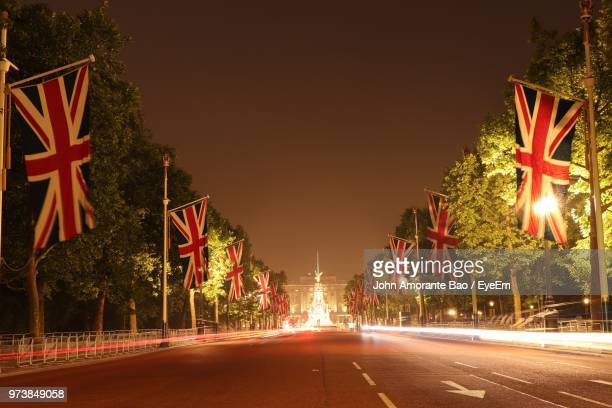 light trails on road against sky at night - buckingham palace stock pictures, royalty-free photos & images