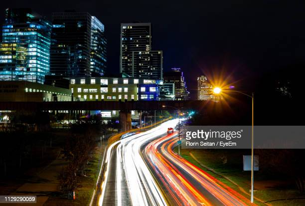 light trails on road at night - florin seitan stock pictures, royalty-free photos & images