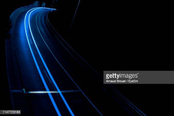 light trails on road at night - parallel stock pictures, royalty-free photos & images