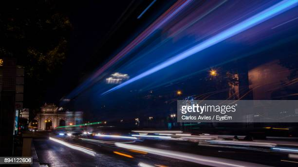 light trails on road at night - carlos aviles stock pictures, royalty-free photos & images