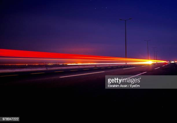 light trails on road at night - jiddah stock pictures, royalty-free photos & images