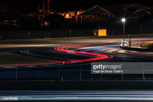 light trails on road in city at night - motorsport stock pictures, royalty-free photos & images