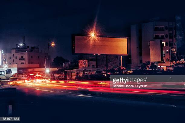 light trails on road in city at night - dakar senegal stock pictures, royalty-free photos & images