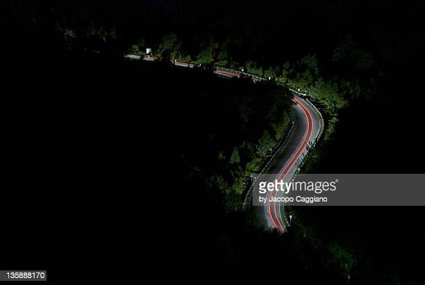 light trails on road, italy - jacopo caggiano stock pictures, royalty-free photos & images