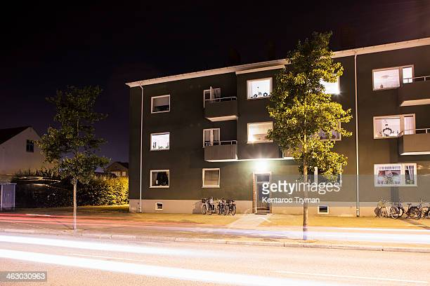 Light trails on street in front of residential building