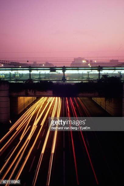 light trails on suspension bridge at night - auvergne rhône alpes stock photos and pictures