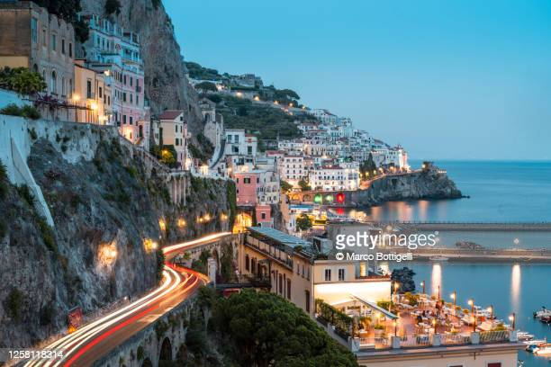 light trails on the road to amalfi, italy - italy stock pictures, royalty-free photos & images