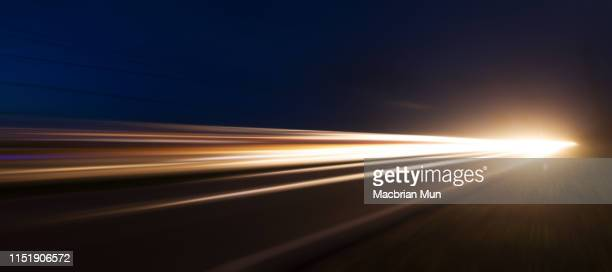 light trails with zoom blur effect for abstract background - velocità foto e immagini stock