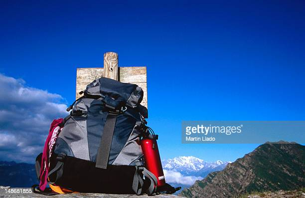 Light trekking backpack against sign with Monte Rosa in background.