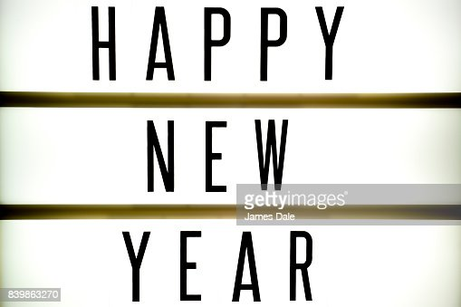 A Light Up Board Displaying The Phrase Happy New Year Stock Photo ...